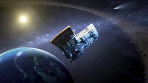 This artist's concept shows the Wide-field Infrared Survey Explorer, or WISE spacecraft, in its orbit around Earth.  NASA/JPL-Caltech